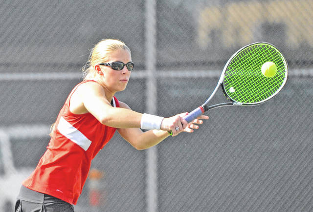 Josh Brown|Troy Daily News Milton-Union's Hannah Fugate puts away a volley at the net during a match at the Division II sectional tournament Saturday at Troy High School.