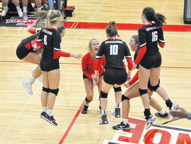 Josh Brown|Troy Daily News The Tippecanoe volleyball team celebrates after winning the final point in a victory over Troy Tuesday at Tippecanoe High School.