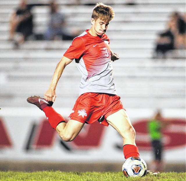 Lee Woolery|Troy Daily News Troy senior Connor Hubbell scores on a direct kick during the Trojans' Senior Night game against Piqua Tuesday at Troy Memorial Stadium.