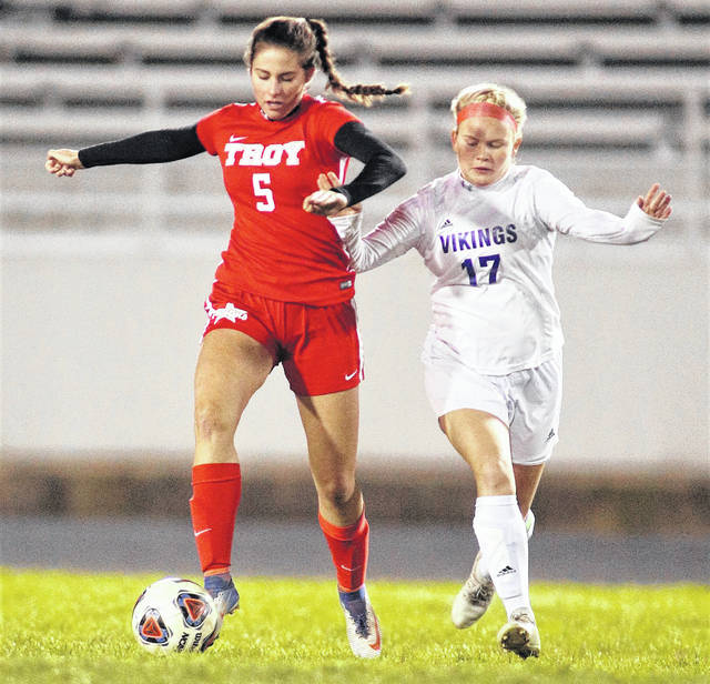 Lee Woolery|Troy Daily News Troy's Ciena Miller gets around a Miamisburg defender Tuesday in a first-round tournament game at Troy Memorial Stadium.