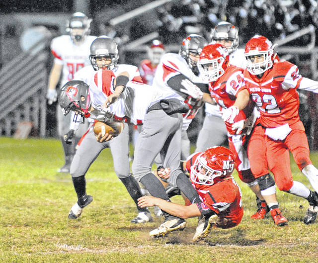 Josh Brown|Troy Daily News Milton-Union's Dylan Schenck (45) sacks the Dixie quarterback Friday night during the Bulldogs' 61-0 victory.