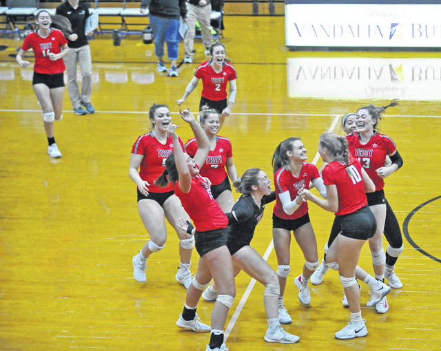 Josh Brown|Troy Daily News The Troy volleyball team rushes the court after winning the Division I sectional final against Miamisburg Wednesday at Butler High School.