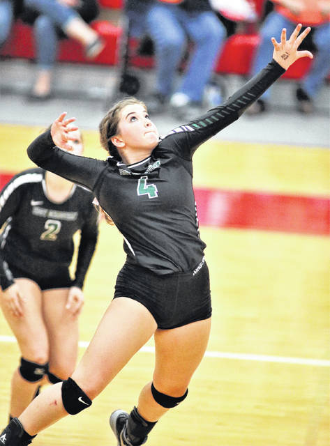 Lee Woolery|Troy Daily News Troy Christian's Jalyn Forrer goes up for a kill during a Division IV sectional final against Jackson Center Wednesday at the Trojan Activities Center.