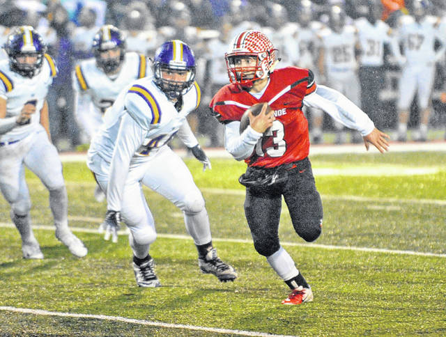 Josh Brown|Troy Daily News Tippecanoe's Jackson Yeager breaks a long run Friday night against Butler.