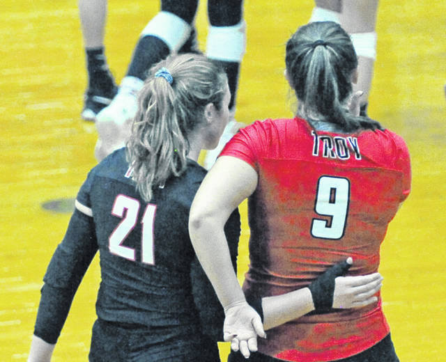Josh Brown|Troy Daily News Troy seniors Alexa Holland (21) and Payton Riley (9) walk off the court for the last time after Saturday's Division I district final match against Ursuline Academy at Butler High School.