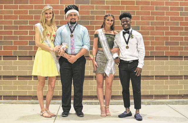 "Provided photo The 2018 Homecoming Royalty at Bethel High School has been announced, including, from left, queen Klaudia Lowery, king John Butler, princess Connor Heck, and prince Darrius Smith. The royals were announced on Friday, Oct. 5 following the homecoming parade. This year's theme was ""Midnight Masquerade."""