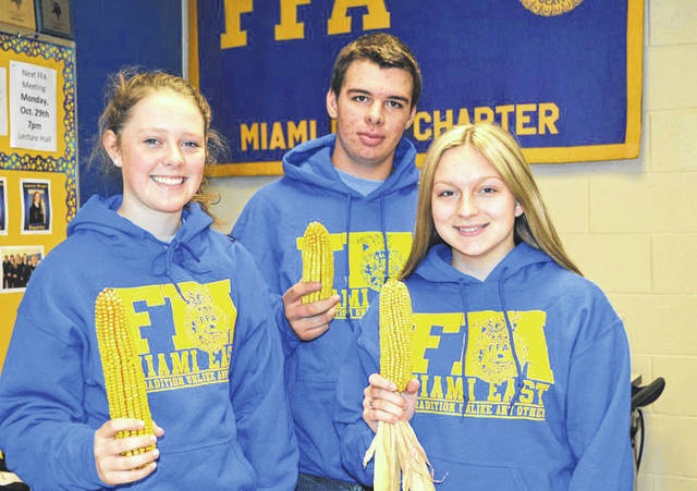 Provided photo The top three finalists of the Miami East-MVCTC FFA Chapter Corn Contest were, left to right, Lauren Wright, Samuel Sutherly and Paige Pence.