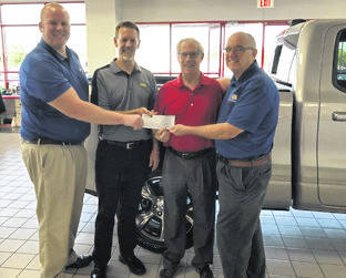 "Provided photo Erwin Chrysler, currently celebrating more than 40 years in Troy, was able to make a donation of $3,900 to the United Way of Miami County following its 16th annual car show. ""We had a great turnout and the weather was beautiful. We know funding for community programs is hard to come by, and we want to do our part to help make sure these programs remain available,"" said Ron Erwin, owner of Erwin Chrysler. ""We're excited to raise money for United Way of Miami County."""