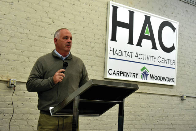 Cody Willoughby | Troy Daily News Representative Stephen Huffman addresses attendees during the open house for the new Habitat Activity Center on Thursday in Troy.