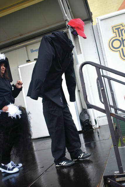 Cody Willoughby | AIM Media Midwest Carter Miller, 9, of Troy departs the stage in Prouty Plaza as the Invisible Man during Hometown Halloween on Saturday, Oct. 27 in Troy.