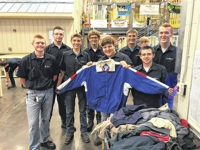 Provided photo Electrical Trades students are leading the annual coat drive at UVCC. They have filled a crate with just some of the 130 coats collected to date.