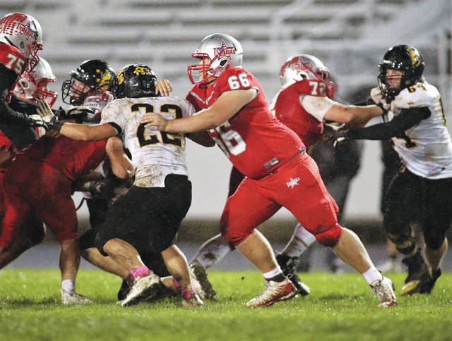 Lee Woolery | Troy Daily News Offensive guard Ethan Freed clears the way for the Troy offense last Friday against Sidney.