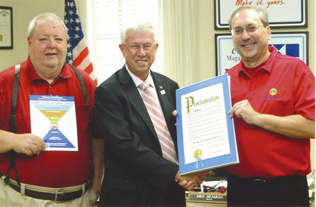 Provided photo Troy Mayor Michael Beamish presents Lions Club President Steve Kaplan, right, and Lions Club's Campaign Chair Bob Medley, left, with the signed proclamation.