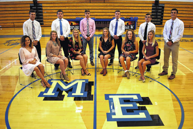 "Cody Willoughby | Troy Daily News The 2018 Senior Homecoming Court has been announced at Miami East High School. Court members include: seated from left, Alivia Bevan, Whitley Gross, Kaitlyn Hawes, Ashlyn Monnin, Maria Staton, and Laci Wells, and standing from left, Justin Brown, Brenden Dalton, Parker Heim, Gavin Horne, Vincent Villella, and Connor Wilson. This year's theme is ""Pardi Gras."" The king and queen will be announced on Friday, Oct. 12, at 6:45 p.m. at the Miami East stadium, ahead of the football game against the Arcanum Trojans. A dance will be held at the Miami East Board of Education gymnasium on Saturday, Oct. 13, from 7-10:30 p.m."