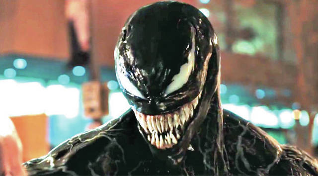 "Provided photo A symbiote reigns terror on nameless baddies in ""Venom."""