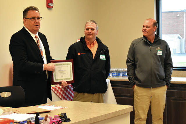 Cody Willoughby | AIM Media Midwest UVCC Director Pat Gibson recognizes Mark Wiseman of Levin Porter Architects and Jay Westerheide of Westerheide Construction during the open house and ribbon cutting ceremony for the new Veterinary Science center on Thursday at Upper Valley Career Center.