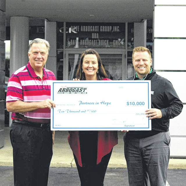 Provided photo Left to right are Dave Arbogast, Jessica Echols, and Blake Arbogast of Arbogast Buick GMC, who recently hosted their third annual charity golf tournament and presented Partners in Hope, Inc., with a gift of $10,000.