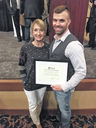 Provided photo Heritage Ohio presented the Main Street Business of the Year award to Noah and Meggin Walkup of Purebred Coffee Co. at their annual Preservation and Revitalization Awards ceremony held Tuesday, Oct. 23 in downtown Cleveland.