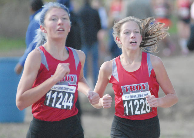 David Fong | Miami Valley Sunday News Troy's Olivia Tyre (left) and Dinah Gigandet compete Saturday at the Greater Western Ohio Conference meet at Northmont High School.