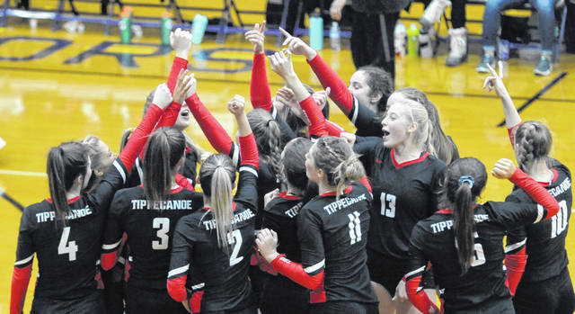 Josh Brown|Troy Daily News The Tippecanoe volleyball team huddles before facing Roger Bacon in the Division II regional semifinal Thursday at Butler High School.