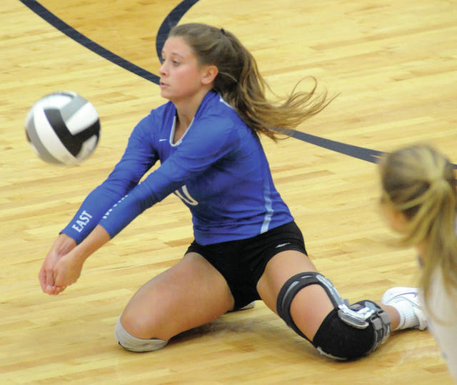 Mike Ullery|AIM Media Miami East libero Gabrielle Hawkins goes low for a dig during Thursday's Division III regional semifinal against Versailles at Fairmont's Trent Arena.