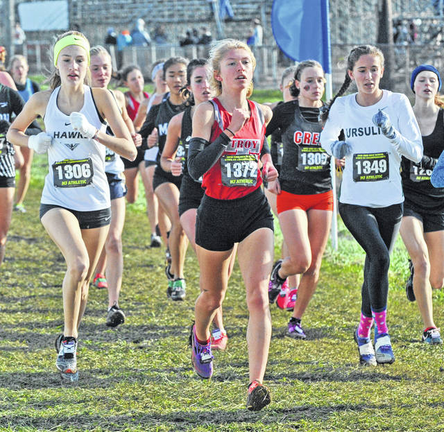 Josh Brown | Miami Valley Sunday News Troy's Olivia Tyre (center) placed 13th in her fourth and final race Saturday at the state cross country meet.