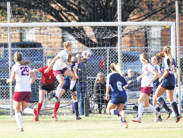 Photo courtesy Lee University Lee University's Lauren Weimer, a Tippecanoe High School graduate, heads in the game-winning goal against Columbus State on Nov. 18 to send the Flames women's soccer team to its first-ever NCAA Division II Final Four appearance.