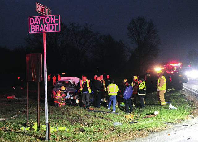 Mike Ullery | Troy Daily News First responders from Elizabeth Township, Christiansburg, New Carlisle and the Miami County Sheriff's Office work at the scene of a two-vehicle fatal crash on State Route 41 at Dayton-Brandt Road on Wednesday evening.