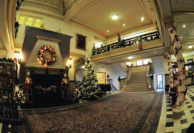 Mike Ullery | Daily Call The Fort Piqua Plaza and Piqua Public Library are decorated for the holiday season. The library has a number of Crhistmas/holiday items on display, including a community Christmas tree display on the second floor.