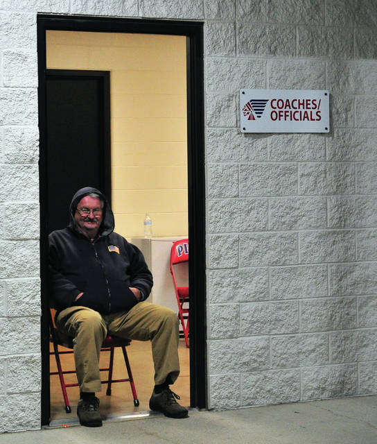 Mike Ullery | Daily Call Cecil Stewart of Piqua works the officials locker room during Friday's OHSAA state semi-finals gootball game at Alexander Stadium/Purk Field. Piqua game workers continue to work playoff games well after the regtular season his finished.