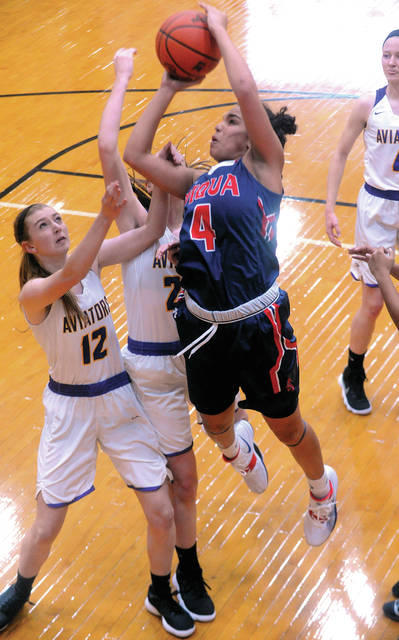 Piqua's Tylah Yeomans shoots over Vandalia-Butler's Ella Neely (12) and Evan Neely Wednesday.