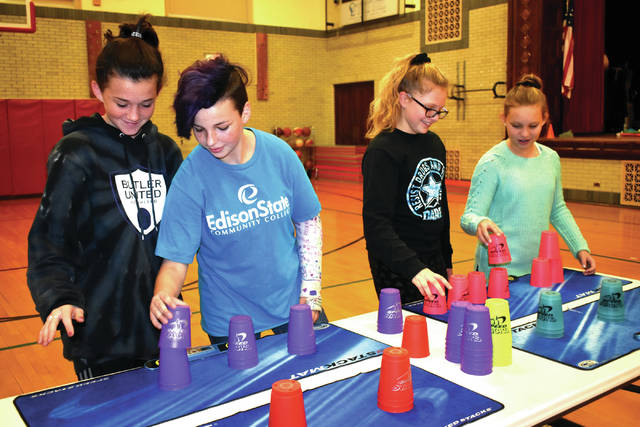 Cody Willoughby | Troy Daily News From left, sixth graders Brooklyn Ganger, Addisyn Russell, Mia Luciano, and Tatum Jackson participate in the 2018 'Stack Up!' challenge on Wednesday at Van Cleve Elementary in Troy.