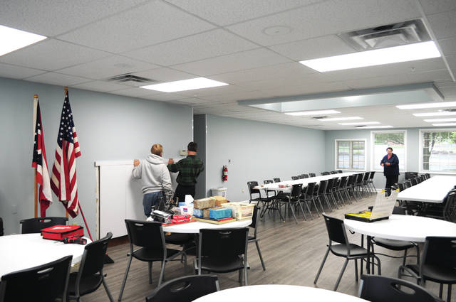 Cecilia Fox | AIM Media Workers ready the main meeting room in the seniors new location at 528 N. Hyatt in Tipp City a week before the center's opening.