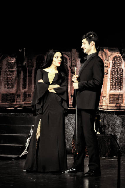 "Cecilia Fox | Troy Daily News Gomez and Morticia Addams, portrayed by Luke Huffman and Alexis Collins, are concerned about their teenage daughter Wednesday's interest in a normal young man. Milton-Union High School's production of ""The Addams Family"" opens Friday night."