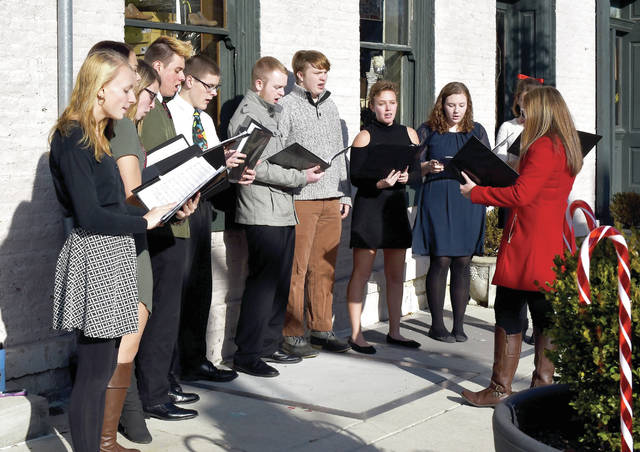 Provided photo A local choir entertains visitors to the annual Christmas in the Village event in Tipp City.