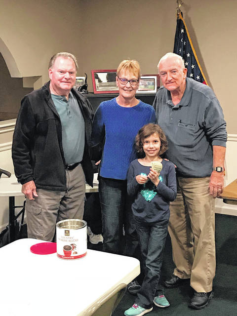 Provided photo Hailey Bechtol, 7, of Troy, stands with, from left, FOP Vice President Jack Hoekstra, Penny Hoekstra, and FOP President Billie Ray after a donation of $106 to needy kids on Oct. 29 at the Miami County FOP Lodge 58.