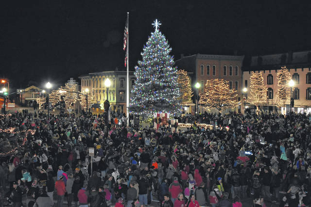 Cody Willoughby | Troy Daily News A square full of spectators look on as the tree and surrounding decorations are lit at the Grand Illumination on Friday in Troy.