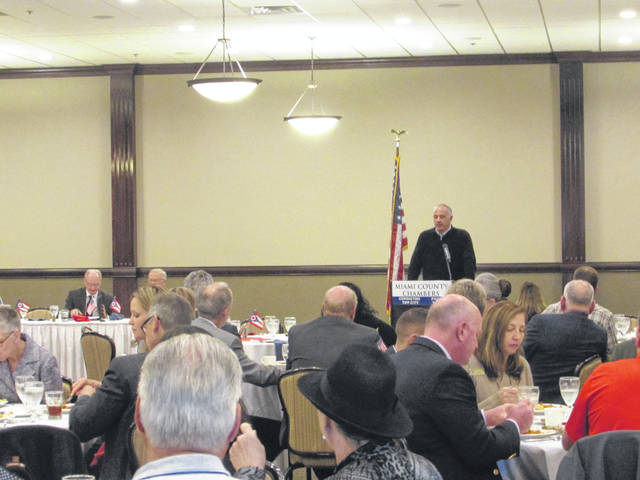 Sam Wildow | AIM Media Midwest State Rep. Steve Huffman addresses the Miami County Chambers of Commerce at a Friday luncheon at the Concord Room in Troy.