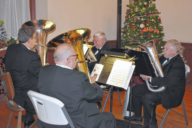 "From left, Michael Gallehue, Denny Seifried, Ted Shuttleworth, and Francis Laws perform ""Alleluia"" during a concert on Tuesday at Troy-Hayner Cultural Center."