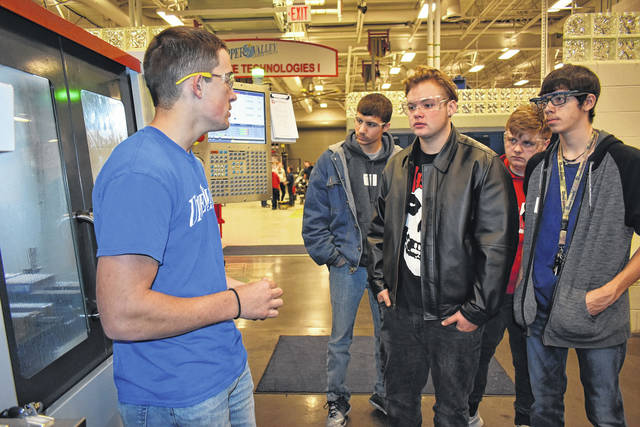 "Cody Willoughby | Troy Daily News UVCC apprentice student Isaiah Curl demonstrates the functions of a CNC machine to Troy High School tenth graders Kristofer Aellens, Sebastian Bore, Austin Robinette, and Jesse Symonds during ""Explore Career Day"" on Wednesday at Upper Valley Career Center."
