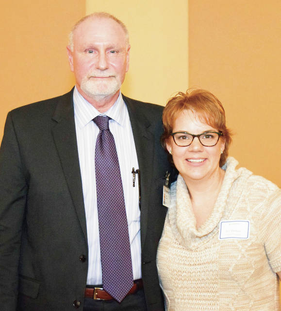 Provided photo Upper Valley Medical Center President Tom Parker presents the UVMC 2018 Employee of the Year, nurse Ivy Thoman.