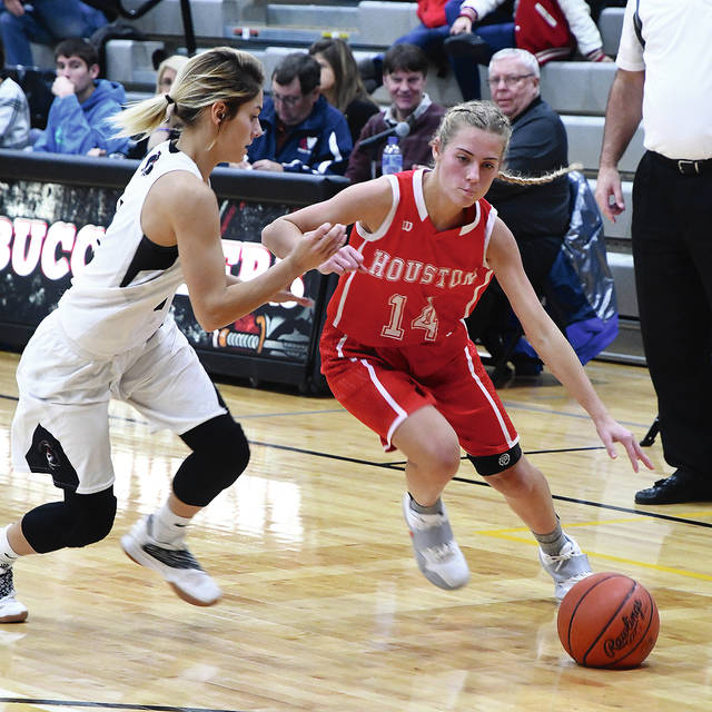 Ben Robinson|GoBuccs.com Houston's Hollie Voisard drives against Covington's Morgan Lowe.