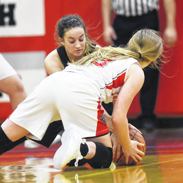 Ben Robinson|GoBuccs.com Covington's Makenzee Maschino battles for a loose ball Thursday night.