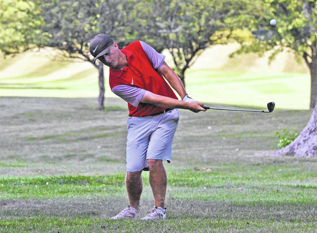 Josh Brown | Miami Valley Today file photo Troy's Holden Scribner pitches onto the green at the Urbana Invitational in August.