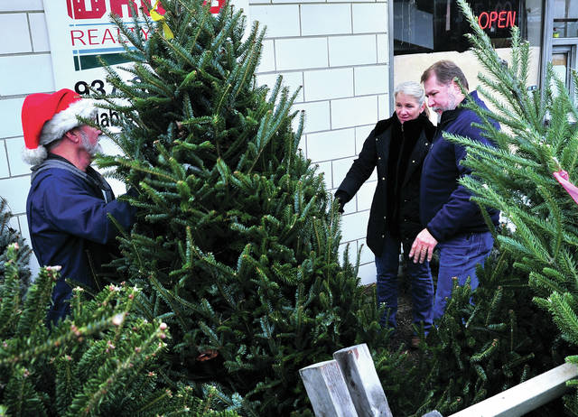 Mike Ullery | Daily Call Terry and Renee Waag of Covington select their 2018 Christmas tree at George's Dairy Bar tree lot on Friday. George's is one of a variety of local places to purchase live Christmas trees.