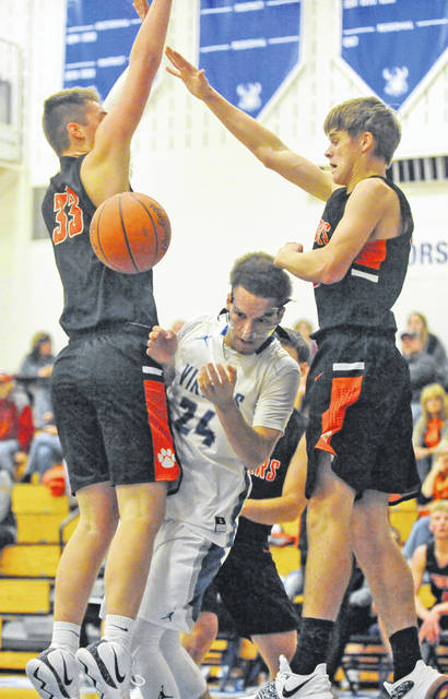 Josh Brown Miami Valley Sunday News Miami East's Will Hudson splits a West Liberty-Salem double team and loses possession of the ball Saturday night at Miami East High School. Hudson, who led the Vikings in scoring, would get the ball back and score on the play.