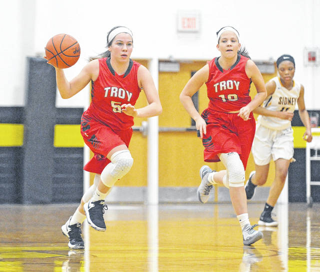 Josh Brown|Miami Valley Today Troy's Macie Taylor (5) and MaKenna Taylor (10) run the fast break Wednesday at Sidney.