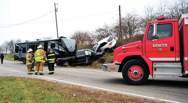 Mike Ullery | Daily Call Authorities investigate a crash at the intersection of Piqua-Lockington and Landman Mill Road on Thursday morning. Two persons were transported by Piqua Fire Department medics with non-life-threatening injuries. The crash is under investigation by the Miami Co. Sheriff's Office.