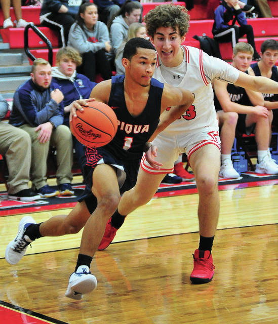 Piqua's Qurri Tucker drives to the basket against Tippecanoe's Peter Guevara Friday night.