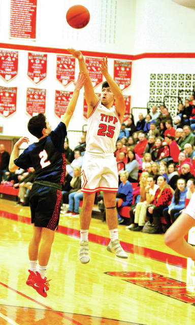 Mike Ullery|AIM Media Tippecanoe's Ben Sauls hits a 3-pointer Friday against Piqua.